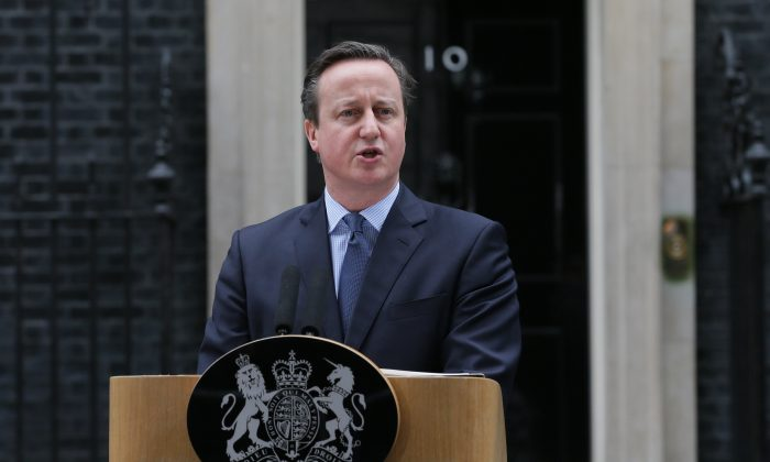 British Prime Minister David Cameron makes a statement outside 10 Downing Street in London, Saturday Feb. 20, 2016. (AP Photo/Tim Ireland)