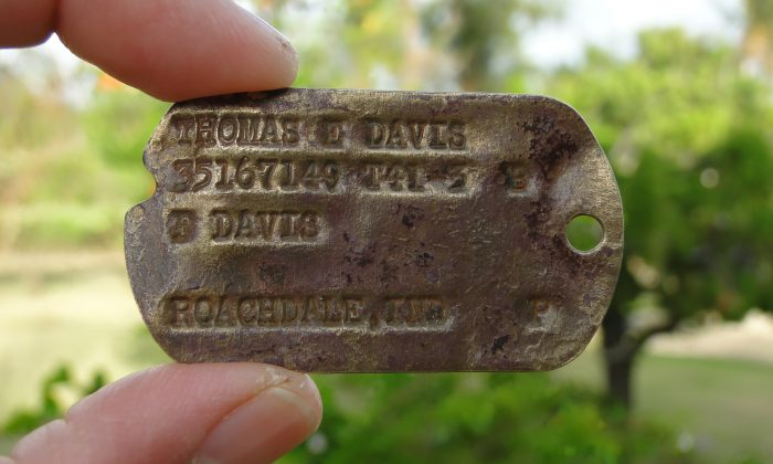 This Feb. 13, 2016 photo provided by Genevieve Cabrera shows World War II Pfc. Thomas E. Davis' Army dog tag that was found in a farm field in Saipan in early 2014.  Davis earned one of the nation's highest military honors after surviving the bloody fighting on Saipan only to die during the even bloodier battle for Okinawa nearly a year later. (Genevieve Cabrera via AP)