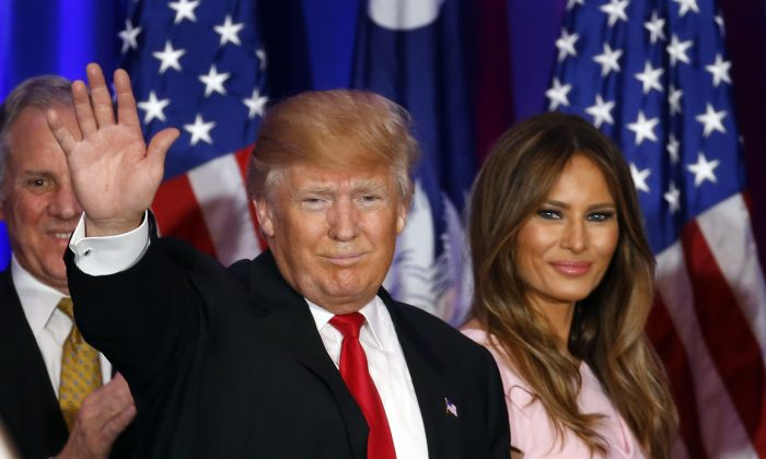 Republican presidential candidate Donald Trump and his wife Melania during a South Carolina Republican primary night event in Spartanburg, S.C., on Feb. 20, 2016. (AP Photo/Paul Sancya)