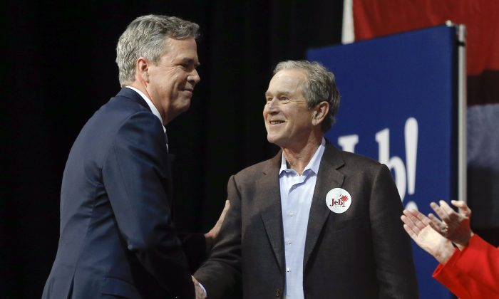 Republican presidential candidate and former Florida Gov. Jeb Bush, left, shakes hands with his brother former President George W. Bush during a campaign stop Monday, Feb. 15, 2016, in North Charleston, S.C. (AP Photo/Matt Rourke)