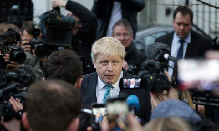 London Mayor Boris Johnson makes a statement outside his home in London, Sunday Feb. 21, 2016. (AP Photo/Tim Ireland)