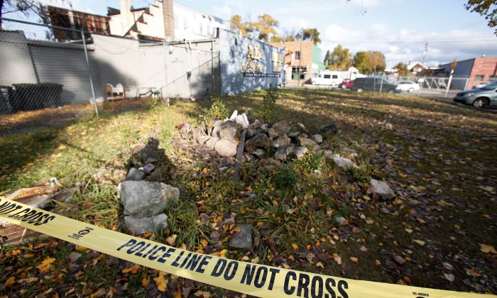 Crime scene tape stretched across the location where 10 people were shot at Al's Place Barber Shop in Detroit, Michigan, on Nov. 7, 2013. (Bill Pugliano/Getty Images)
