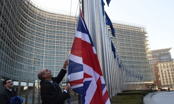 The British flag is hoisted ahead of British Prime Minister visit at the European Commission in Brussels, on February 16, 2016 (Emmanuel Dunand/AFP/Getty Images)
