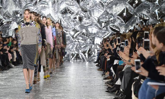 Models walk the runway at the Mary Katrantzou show during London Fashion Week Autumn/Winter 2016/17 at Central Saint Martins in London on Feb. 21, 2016. (Stuart C. Wilson/Getty Images)