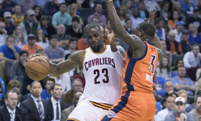 LeBron James has won four MVPs and two NBA titles in his career. (J. Pat Carter/Getty Images)