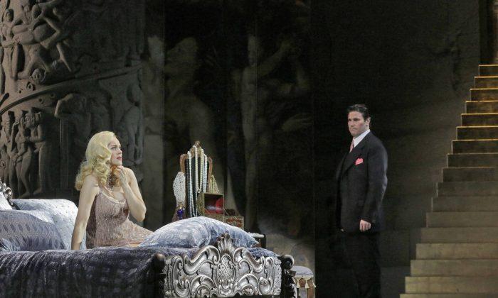 """Kristine Opolais in the title role and Massimo Cavalletti as Lescaut in Puccini's """"Manon Lescaut"""". (Ken Howard/ Metropolitan Opera)"""