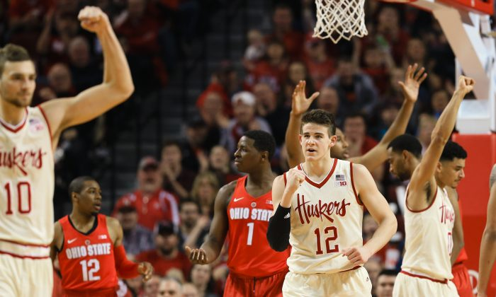 Nebraska's Michael Jacobson (C), Jack McVeigh (L) and Tai Webster (R) rallied to take Ohio State to overtime but fell 65–62 in the extra session. (AP Photo/Nati Harnik)