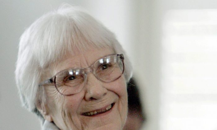 "In this Aug. 20, 2007, file photo, author Harper Lee smiles during a ceremony honoring the four new members of the Alabama Academy of Honor at the Capitol in Montgomery, Ala. Lee, elusive author of best-seller ""To Kill a Mockingbird,"" died Friday, Feb. 19, 2016, according to her publisher, Harper Collins. She was 89. (AP Photo/Rob Carr, File)"