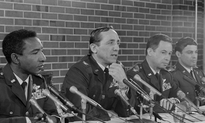 Four former prisoners of war tell newsmen that they all recall being subjected to severe torture and beatings during their confinement, at Andrews Air Force Base near Washington, March 29, 1973. From left: Lt. Col. Fred V. Cherry, Col. Robinson Risner, Col. Norman C. Gaddis, and Maj. John A. Dramesi.  (AP Photo/Henry Griffin)