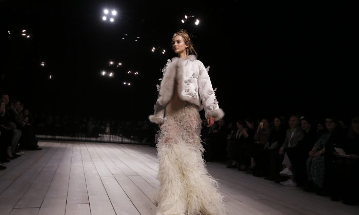A model displays a design during the Alexander McQueen Autumn/Winter show at London Fashion Week, Sunday, Feb. 21, 2016. (AP Photo/Kirsty Wigglesworth)