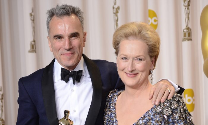 """(L–R) Actor Daniel Day-Lewis, winner of the Best Actor award for """"Lincoln,"""" and presenter Meryl Streep pose in the press room during the Oscars held at Loews Hollywood Hotel in Hollywood, Calif., on Feb. 24, 2013. (Jason Merritt/Getty Images)"""
