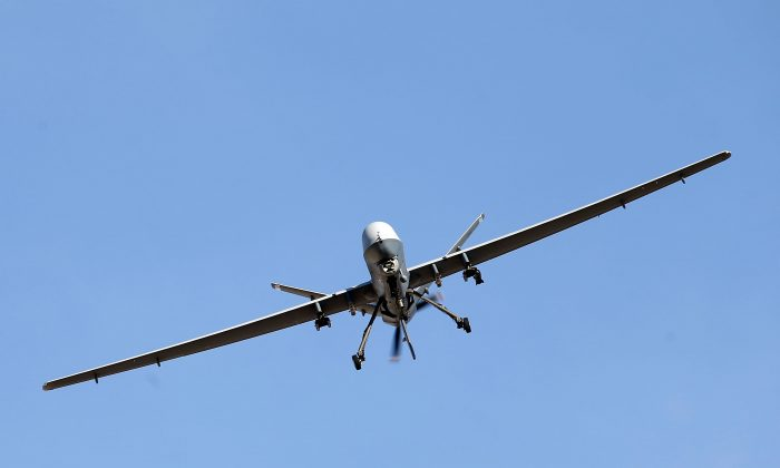 An MQ-9 Reaper remotely piloted aircraft (RPA) flies by during a training mission at Creech Air Force Base in Indian Springs, Nev., on Nov. 17, 2015. (Isaac Brekken/Getty Images)