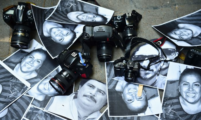 Photos of killed journalists and cameras outside the Veracruz state representation office during a journalists protest in Mexico City on Feb. 11, 2016. (Ronaldo Schemidt/AFP/Getty Images)