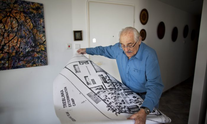 Holocaust survivor Samuel Willenberg displays a map of Treblinka extermination camp during an interview with the Associated Press in Tel Aviv, Israel, on Oct. 31, 2010. Willenberg, the last survivor of Treblinka, the Nazi death camp where 875,000 people were killed, has died at 93. Willenberg was among a group of Jews who in 1943 set fire to the camp and headed to the woods. Hundreds fled, but most were killed by Nazi troops in the surrounding mine fields or captured by Polish villagers. (AP Photo/Oded Balilty)