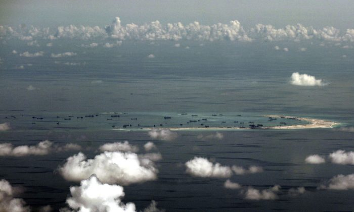An aerial shot shows China's reclamation of Mischief Reef in the Spratly Islands in the South China Sea on May 11, 2015. (Ritchie B. Tongo/AP Photo)