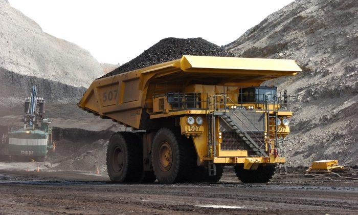A mining dumper truck hauls coal at Cloud Peak Energy's Spring Creek strip mine near Decker, Mont., on April 4, 2013. (AP Photo/Matthew Brown)