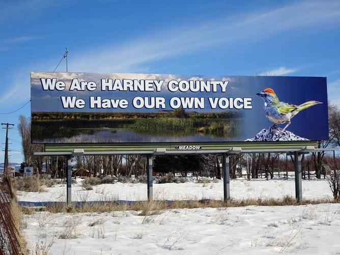 A billboard in Harney County during the Malheur Occupation reflected most locals' unhappiness with the occupiers from outside the county. (Peter Walker)