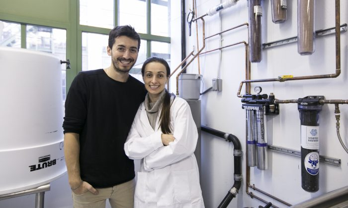 Organic Gemini founders Mariam Kinkladze and George Papanastasatos in front of the 4-step water purification system the company uses to make its TigerNut Horchata, in their new manufacturing facility in Brooklyn, New York, on Feb. 18, 2016. (Samira Bouaou/Epoch Times)
