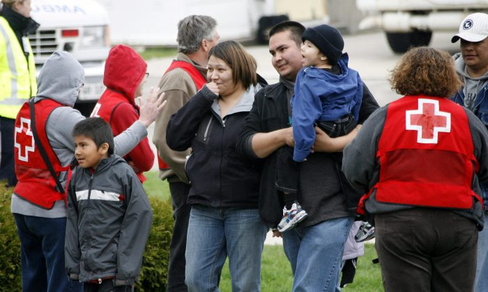 People from the Kashechewan community arrive in Stratford, Ont., after being evacuated due to flooding in April 28, 2008. First Nations leaders from northern Ontario are calling for urgent action to address a range of serious issues facing their communities. (The Canadian Press/ Dave Chidley)