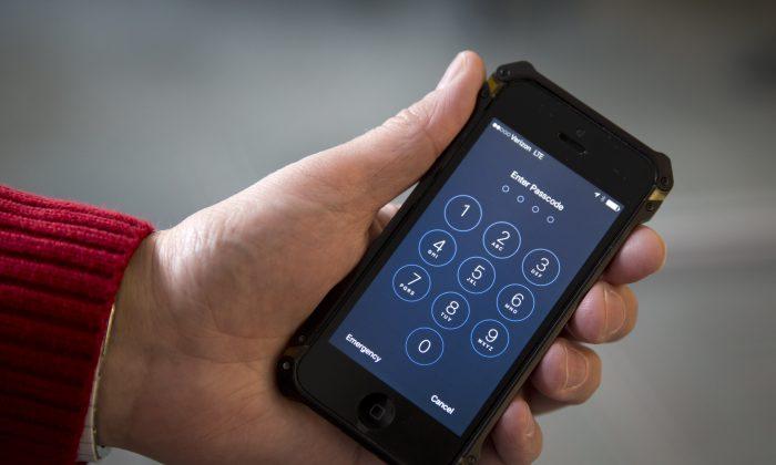 An iPhone is seen in Washington, Wednesday, Feb. 17, 2016. (AP Photo/Carolyn Kaster)