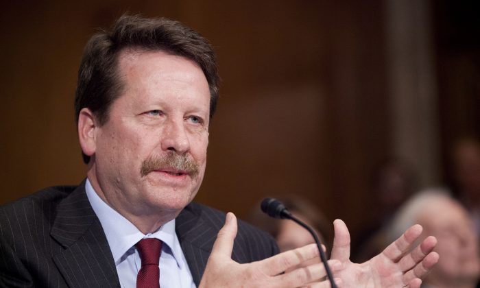 FILE - In this Nov. 17, 2015 file photo, Dr. Robert Califf, President Barack Obama's nominee to lead the Food and Drug Administration (FDA), testifies on Capitol Hill in Washington. (AP Photo/Pablo Martinez Monsivais, File)