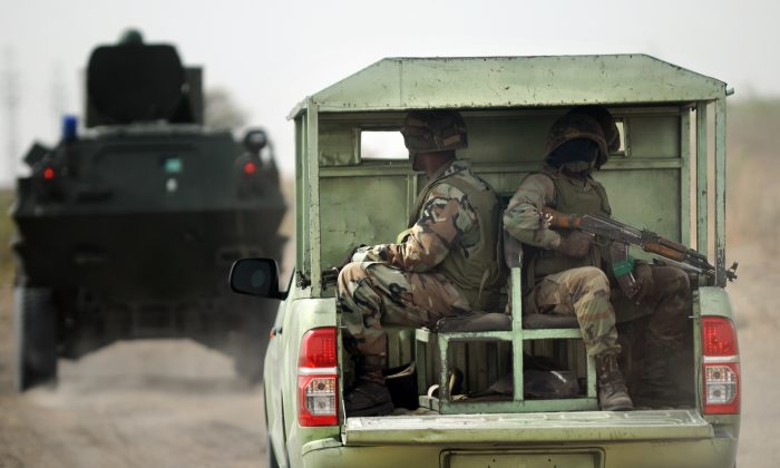 Nigerian soldiers patrol in the north of Borno state close to a Islamic extremist group Boko Haram former camp near Maiduguri on June 5, 2013. (Quentin Leboucher/AFP/Getty Images)