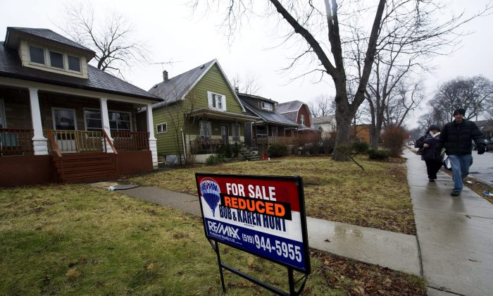 A home for sale at a reduced price in Windsor, ON in this file photo. With the drop in consumer confidence, more than half of Canadians feel now is not the time for purchases of big-ticket items like homes and cars. (The Canadian Press/Nathan Denette)