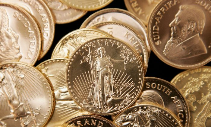 American Eagle and South African Krugerrand gold bullion at the Chicago Coin Company in Chicago, Ill., on May 11, 2006. Monetary Metals, Inc. wants to make gold useful in the economy again. (Scott Olson/Getty Images)