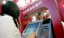 Tricked Into Making a $400 Transaction, Chinese Woman Uses Coke to Destroy ATM