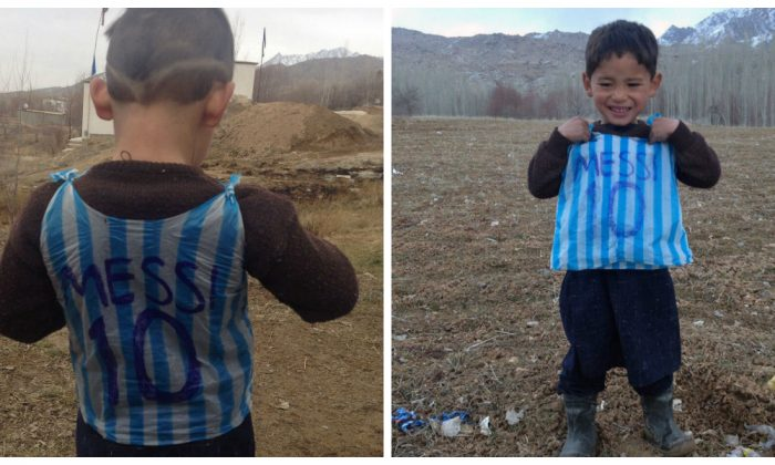 These photos were taken on Jan. 24 and were provided by the family of 5-year-old Afghan boy—and a big Lionel Messi fan—named Murtaza Ahmadi. He's wearing an Argentina football shirt made out of a plastic bag with his hero Lionel Messi's name. (STR/AFP/Getty Images)