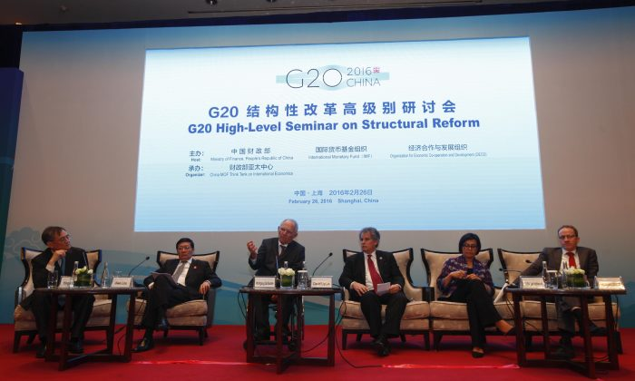 (L-R) Moderator Yingyi Qian, Chinese Finance Minister Lou Jiwei, German Finance Minister Wolfgang Schaeuble, IMF First Deputy Director David Lipton, World Bank Managing Director Sri Mulyani Indrawati, and Breugel Director Guntram Wolff compose a panel during a session of the G20 High-Level Seminar on Structural Reform, ahead of the G20 Finance Ministers and Central Bank Governors Meeting at the Pudong Shangri-la Hotel in Shanghai, China, on Feb. 26, 2016. (Rolex Dela Pena/AP)