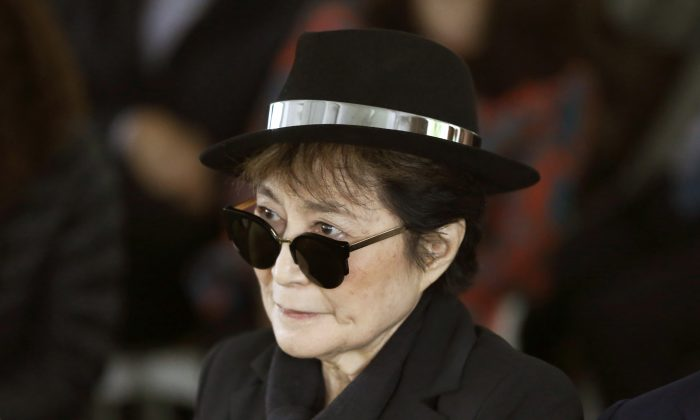 Artist Yoko Ono appears during a ceremony announcing the future installation of her first permanent public art installation in the U.S., in Chicago,  June 12, 2015. Ono was  hospitalized Feb. 26, 2016 for flu-like symptoms. (AP Photo/Charles Rex Arbogast)