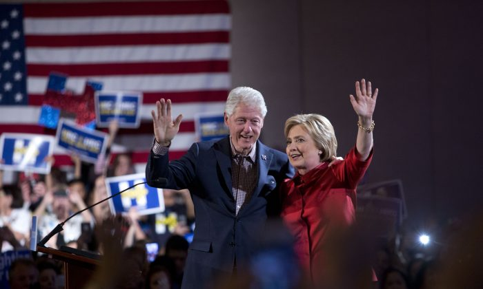Former President Bill Clinton and Democratic presidential candidate Hillary Clinton wave after Hillary Clinton's victory speech for the Nevada caucuses at Caesars Palace in Las Vegas on Feb. 20, 2016. (Las Vegas Sun/Steve Marcus via AP)