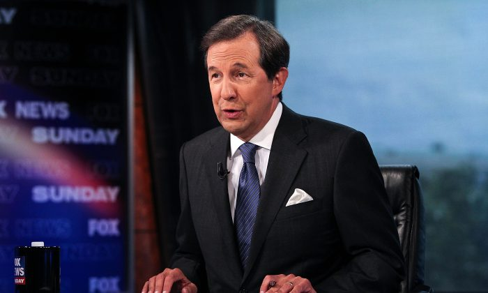 "Chris Wallace takes part in an interview with U.S. Supreme Court Justice Antonin Scalia on  ""FOX News Sunday"" at the FOX News D.C. Bureau on July 27, 2012 in Washington, DC.  (Photo by Paul Morigi/Getty Images)"