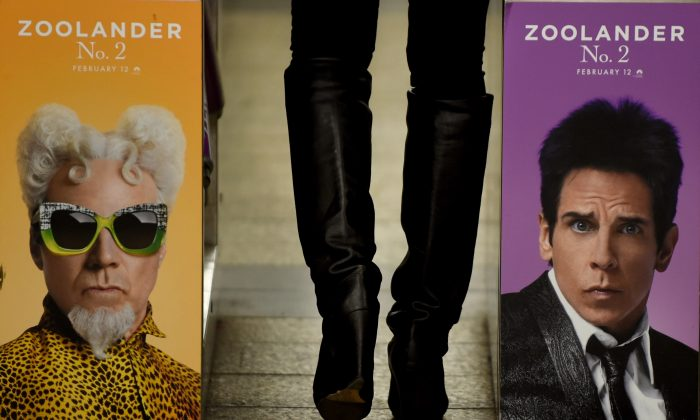 A woman passes through a turnstile that has an advertisment for 'Zoolander 2' featuring Ben Stiller (R) and Will Ferrell, in New York on Feb. 25, 2016. (TIMOTHY A. CLARY/AFP/Getty Images)