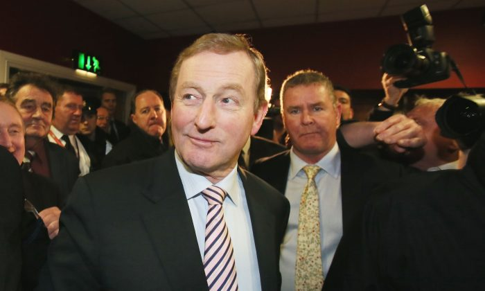 Enda Kenny arrives at the Royal Theatre in Castlebar, Ireland, where counting continues in the Irish general election, on Feb. 27, 2016. (Niall Carson/PA via AP)