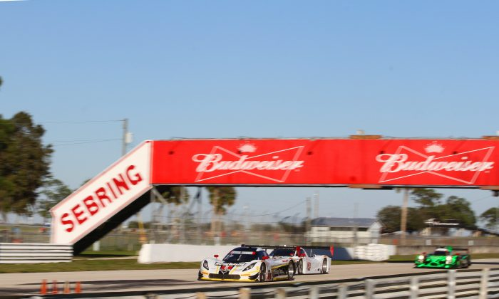The #5 Action Express Coyote-Corvette leads the #24 Alegra Racing Riley--BMW and the #2 Extreme Speed Motorsports Ligier-Honda towards Turn 7 at Sebring Raceway on Thursday afternoon of the IMSA WeatherTech Winter Test. (Chris Jasurk/Epoch Times)