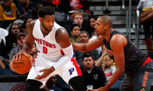 Andre Drummond: Detroit Pistons Center Talks to Young Fan on Bench During Game