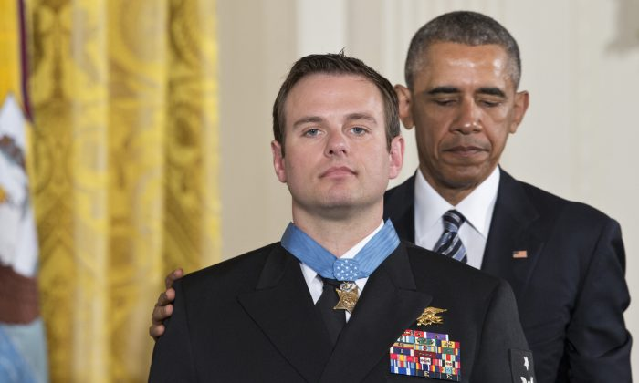 President Barack Obama presents the Medal of Honor to Senior Chief Special Warfare Operator Edward Byers during a ceremony in the East Room of the White House in Washington, Monday, February 29, 2016. Navy Senior Chief Byers received the Medal of Honor for his courageous actions while serving as part of a team that rescued an American civilian being held hostage in Afghanistan on December 8-9, 2012. (AP Photo/J. Scott Applewhite)