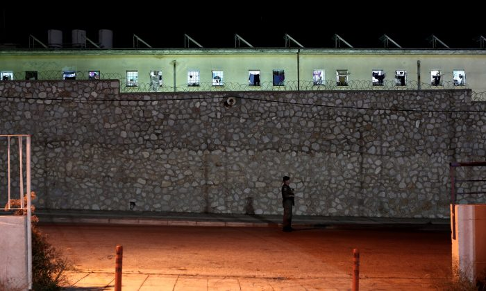 A police officer stands in front of the Korydallos prison in Athens, the largest penitentiary in Greece, on May 3, 2015. (Angelos Tzortzinis/AFP/Getty Images)