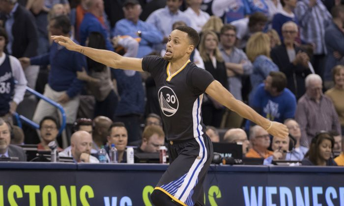 Stephen Curry hit 12 threes in Golden State's overtime win over Oklahoma City. (J Pat Carter/Getty Images)