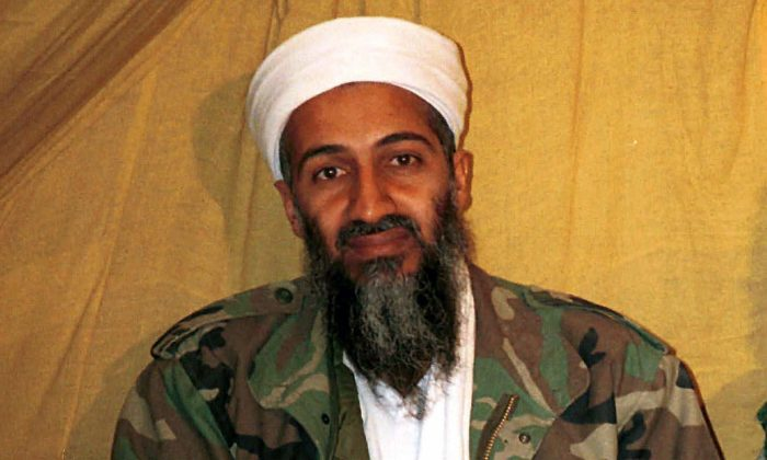 """In this undated file photo Osama bin Laden is seen in Afghanistan. In his last will and testament, bin Laden claimed he had about $29 million in personal wealth, the bulk of which he wanted to be used """"on jihad, for the sake of Allah. (AP Photo)"""