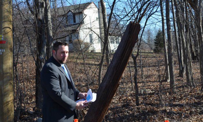 Town of Wallkill Supervisor Dan Depew showing list of double poles in Wallkill on Jan. 22, 2016. (Yvonne Marcotte/Epoch Times)