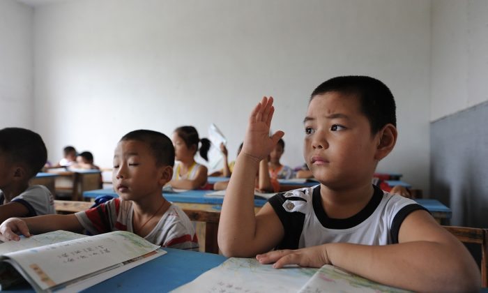 Chinese school children during lessons at a classroom in Hefei, east China's Anhui province on September 20, 2010.(STR/AFP/Getty Images)