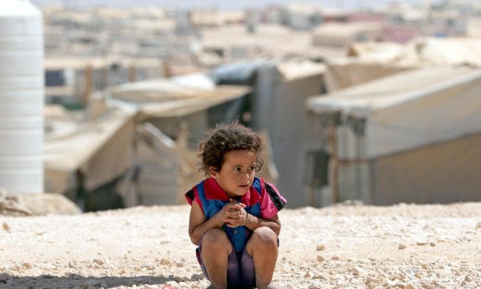 A young Syrian refugee at the U.N.-run Zaatari camp, northeast of the Jordanian capital Amman, on Sept. 19, 2015. (Khalil Mazraawi/AFP/Getty Images)