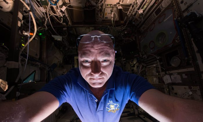 In this June 14, 2015 photo made available by NASA, astronaut Scott Kelly makes a photo of himself as he prepares a scientific experiment on the International Space Station. (Scott Kelly/NASA via AP)