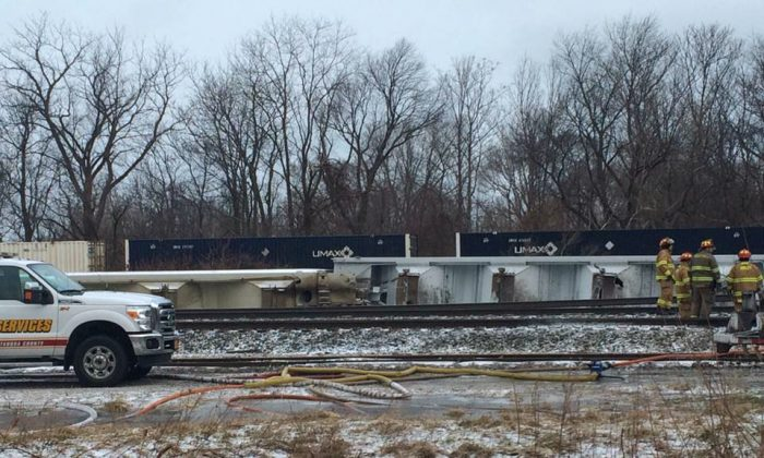 Firefighters work at the site of a 16-car Norfolk Southern freight train derailment that forced the evacuation of dozens of western New York homes after ethanol leaked from two tankers, Wednesday, March 2, 2016, in Ripley, N.Y. (Alice Waters/The Observer via AP)