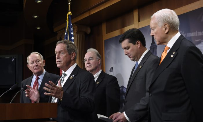 Rep. Joe Wilson (R-S.C.) (2L) speaks during a news conference on Capitol Hill in Washington, D.C., on July 27, 2015, where the Employee Rights Act (ERA) was discussed. Wilson is joined by (L-R) Sen. Lamar Alexander (R-Tenn.), Rep. Tom Price (R-Ga.), Rep. David Rouzer (R-N.C.), and Sen. Orrin Hatch (R-Utah). (AP Photo/Susan Walsh)