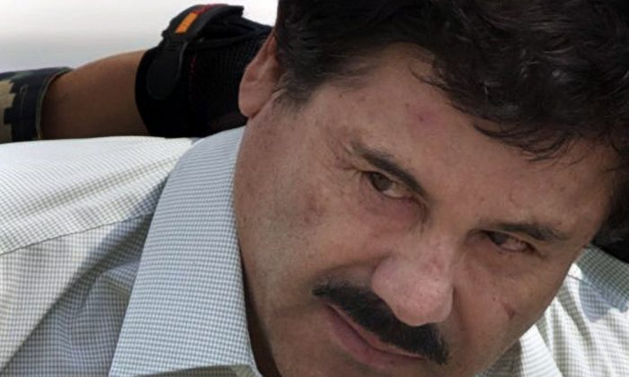 "Joaquin ""El Chapo"" Guzman is escorted to a helicopter by Mexican navy marines in Mexico City, Mexico on Feb. 22, 2014. (AP Photo/Eduardo Verdugo)"