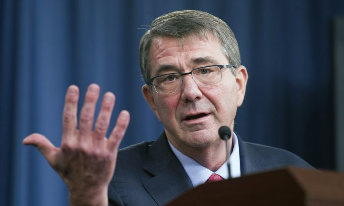 FILE - In this Jan. 28, 2016 file photo, Defense Secretary Ash Carter gestures during a news conference at the Pentagon. (AP Photo/Cliff Owen, File)